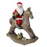 Decoratie kerstman op hobbelpaard