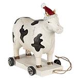 Decoratie koe op wielen